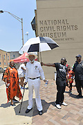 "6/11/16 Memphis, TN. Civil Rights icon James Meredith, 83 years old and wearing   a white shirt, pants and hat,  takes part in a ""Rally Against Fear""  and walks from the Peabody Hotel to the National Civil Rights Museum, where Dr. Martin Luther King was killed, as part of a celebration commemorating the  50th Anniversary of Meredith's  "" March Against Fear.  Meredith set out from Memphis TN on June 6 ,1966, to raise awareness for Equal Rights and to get the African American community to register to vote. Meredith was  shot on the second day of his walk June 7, 1966 in Hernando Mississippi. Martin Luther King, Stokely Carmichael and other notable civil rights leaders of the time joined together to finish Meredith's walk.  Photo ©Suzi Altman"