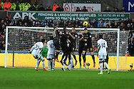 Swansea city's Jonathan de Guzman (20) watches as his free kick flies over the Man city wall.   Barclays Premier league, Swansea city v Manchester City at the Liberty Stadium in Swansea,  South Wales on  New years day Wed 1st Jan 2014 <br /> pic by Andrew Orchard, Andrew Orchard sports photography.