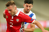 ATHENS, GREECE - OCTOBER 11: Oleg Reabciukof Moldova and Dimitris Limniosof Greece during the UEFA Nations League group stage match between Greece and Moldova at OACA Spyros Louis on October 11, 2020 in Athens, Greece. (Photo by MB Media)
