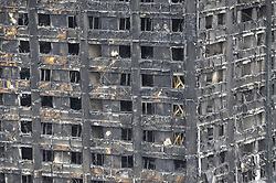 June 23, 2017 - London, UK - London, UK. Wooden supports with support scaffolding can be seen on three floors following work by firefighters.  The burned out Nine days on, police have reported that the Grenfell Tower fire in west London started in a fridge-freezer, and outside cladding and insulation failed safety tests. (Credit Image: © Stephen Chung/London News Pictures via ZUMA Wire)