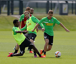 29.06.2015, Trainingsanlage Borussia Moenchengladbach, Moenchengladbach, GER, 1. FBL, Borussia Moenchengladbach, Trainingsauftakt, im Bild v.l. Ibrahima Traore (Moenchengladbach) und Christofer Heimeroth (Moenchengladbach) versuchen Nico Elvedi (Moenchengladbach) den Ball abzunehmen, im Hintergrund beobachten Thorgan Hazard (Moenchengladbach) und Raffael (Moenchengladbach) // during a traning session of German 1st Bundeliga Club Borussia Moenchengladbach at the Trainingsanlage Borussia Moenchengladbach in Moenchengladbach, Germany on 2015/06/29. EXPA Pictures © 2015, PhotoCredit: EXPA/ Eibner-Pressefoto/ Hommes<br /> <br /> *****ATTENTION - OUT of GER*****
