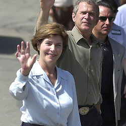 Belton, Texas USA 04JUL00:  Texas Governor and U.S. presidential candidate George W. Bush and wife Laura, accompanied by heavy security, walk the parade route of the Bell County Independence Day parade in downtown Belton Tuesday morning.  The Bushes spent the holiday weekend at their nearby ranch pondering vice-presidential selections.  ©Bob Daemmrich