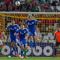 Israel's Eytan Tibi (2nd L), Israel's Rami Gershon (3rd L) and Israel's Avihay Yadin (4th L) go for a header during a friendly football match Hungary playing against Israel in Budapest, Hungary on August 15, 2012. ATTILA VOLGYI