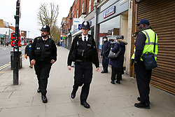 © Licensed to London News Pictures. 03/04/2020. London, UK. Police officers patrol Wood Green High Road in north London as the coronavirus lockdown continues. The Government has ordered that people should go out only for food and health reasons or for work, and keep 2 meters away from other people at all times to slow the spread of the virus and reduce pressure on the NHS. Photo credit: Dinendra Haria/LNP