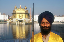 Temple guard at the Golden Temple at Amritsar; Punjab; India; holding spear,