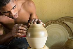 Caribbean, Cuba, Trinidad, potter creating vase on wheel in studio