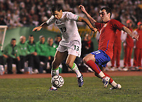 FOOTBALL - FRIENDLY GAME 2010 - ALGERIA v SERBIA - 03/03/2010 - PHOTO MOHAMED KADRI / DPPI - KARIM MATMOUR (ALG) / NENAD MILIJAS (SER)