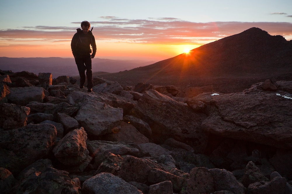 James Meldrum hikes up the Boulder Field below Longs Peak at sunrise, Rocky Mountain National Park, Colorado.