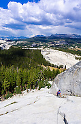 Climber on Marmot Dome above Tuolumne Meadows, Yosemite National Park, California USA