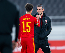 HELSINKI, FINLAND - Thursday, September 3, 2020: Wales' captain Gareth Bale celebrates with Ethan Ampadu at the final whistle during the UEFA Nations League Group Stage League B Group 4 match between Finland and Wales at the Helsingin Olympiastadion. Wales won 1-0. (Pic by Jussi Eskola/Propaganda)