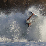A body boarder in action during a big swell in the late afternoon sun at Arpoador Beach near Apoador Point, Rio de Janeiro,  Brazil. 18th August 2010. Photo Tim Clayton
