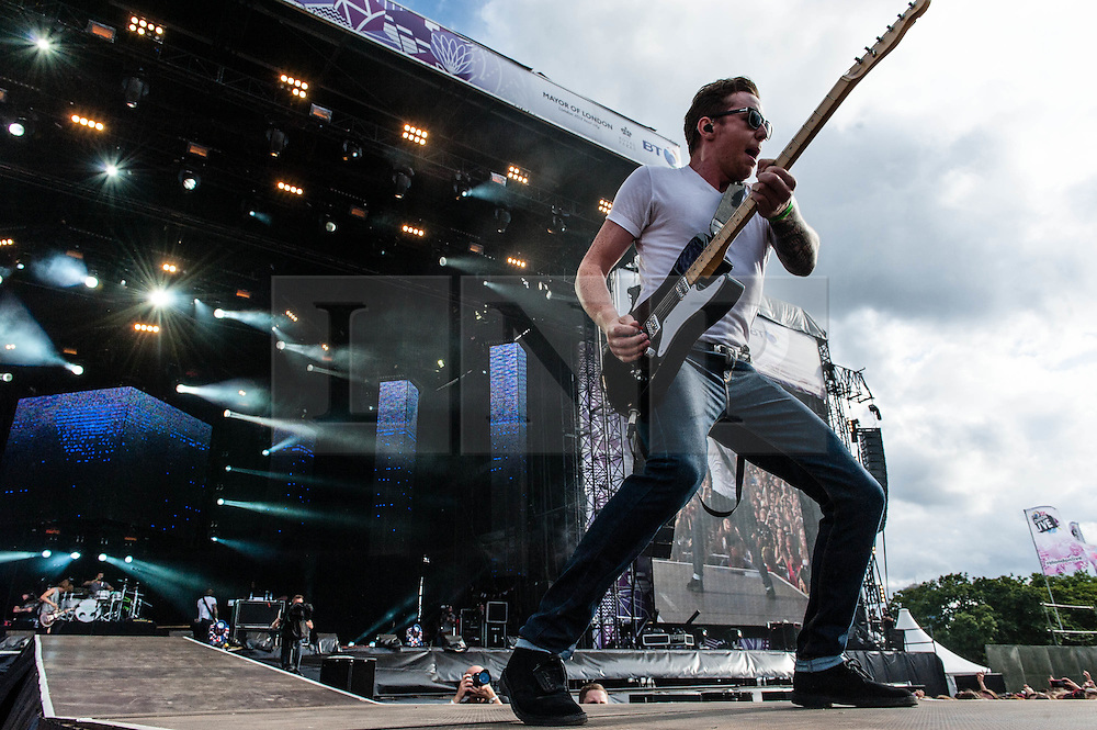 © Licensed to London News Pictures. 03/08/2012. London, UK.  McFly perform live at BT London Live, Hyde Park.  McFly are an English pop-rock band who first found fame in 2004. The band consists of Tom Fletcher (lead vocals, guitar and piano), Danny Jones (lead vocals and guitar), Dougie Poynter (backing vocals and bass guitar) and Harry Judd (drums). In this pic - Danny Jones.  Photo credit : Richard Isaac/LNP