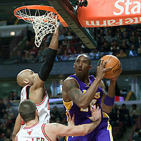 15 December 2009: Los Angeles Lakers guard Kobe Bryant goes for a reverse lay up over Chicago Bulls Taj Gibson during the Los Angeles Lakers 96-87 victory over the Chicago Bulls at the United Center, in Chicago, Illinois, USA.