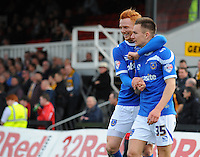 Portsmouth's Jed Wallace (right) celebrates scoring his sides second goal with team-mate Ryan Taylor<br /> <br /> Photo by Kevin Barnes/CameraSport<br /> <br /> Football - The Football League Sky Bet League Two - Newport County AFC v Portsmouth - Saturday 29th March 2014 - Rodney Parade - Newport<br /> <br /> © CameraSport - 43 Linden Ave. Countesthorpe. Leicester. England. LE8 5PG - Tel: +44 (0) 116 277 4147 - admin@camerasport.com - www.camerasport.com
