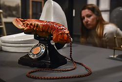 October 3, 2017 - London, UK - London, UK.  A staff member views (L to R) ''Fountain, 1917'', 1964 edition, by Michel Duchamp and ''Lobster Telephone (red)'', 1938, by Salvador Dali with Edward James at the preview of ''Dali / Duchamp'', a new exhibition of works by Salvador Dali and Michel Duchamp taking place at the Royal Academy of Arts in Piccadilly.  Over 80 artworks in different media are on display from 7 October to 3 January 2018. (Credit Image: © Stephen Chung/London News Pictures via ZUMA Wire)