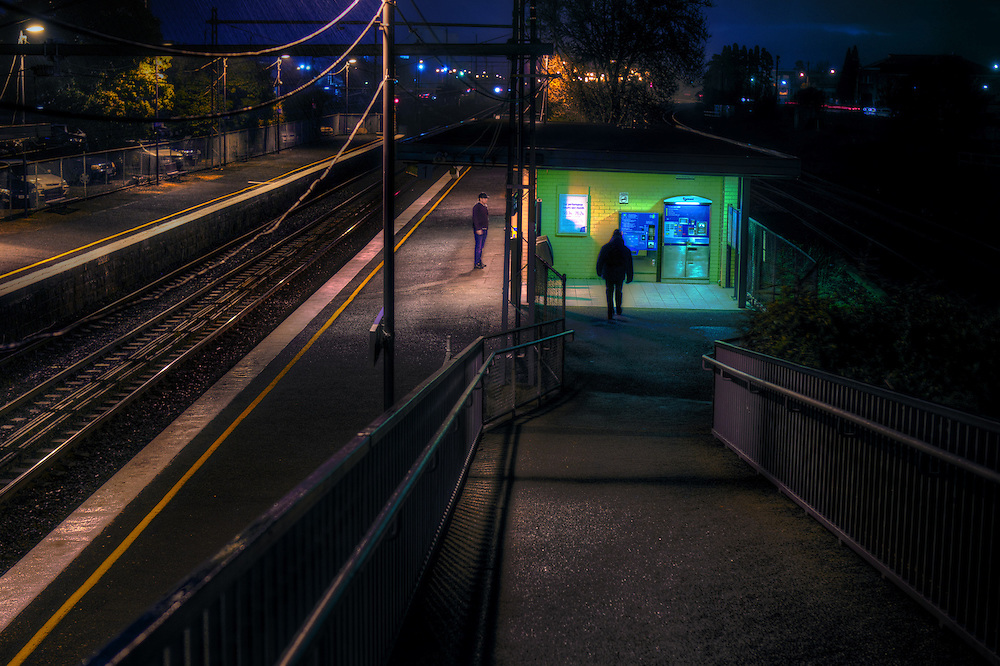 Railway Stations at night. About 6:40pm West Footscray station, a man stands on the outbound platform as a shadowy figure approaches. Pic By Craig Sillitoe CSZ/The Sunday Age/The Age iPad App.15/6/2011 This photograph can be used for non commercial uses with attribution. Credit: Craig Sillitoe Photography / http://www.csillitoe.com<br /> <br /> It is protected under the Creative Commons Attribution-NonCommercial-ShareAlike 4.0 International License. To view a copy of this license, visit http://creativecommons.org/licenses/by-nc-sa/4.0/.
