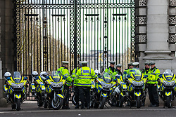 Whitehall, London, February 10th 2016. Police stand by to direct traffic as an estimated 8,000 cabbies hold a go-slow in protest against what they say is unfair competition from minicab and Uber drivers who do not have to undergo the rigorous training and checks required for the licenced taxi trade. ///FOR LICENCING CONTACT: paul@pauldaveycreative.co.uk TEL:+44 (0) 7966 016 296 or +44 (0) 20 8969 6875. ©2015 Paul R Davey. All rights reserved.
