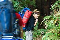 Backpacker takes a water break on Pine Ridge Trail, Big Sur, California.