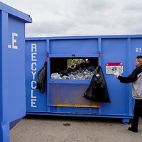 Brian Hubbard deposits his recyclables into the bins near the Larry Brian Mitchell Center in Gallup Wednesday.