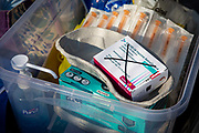 The medical kit used for the home visiting service for housebound patients by Dr Fordham of the Channel Health Alliance dressed in appropriate PPE attends a patient at their home in the community outside Dover to administer the COVID-19 Vaccination on the 27th of February 2021, Dover, Kent, United Kingdom.