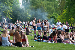 Glasgow, Scotland, UK. 15 May 2019. Warm sunny weather in the city brought hundreds of young sun-seekers to Kelvingrove Park in the city's West End.