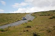 Car driving over moorland near Haytor, Dartmoor national park, Devon, England, UK