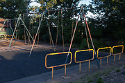 Dawn sunshine in the playground at Ruskin Park, on 30th July 2020, in Lambeth, south London, England.
