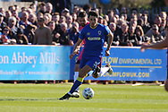 AFC Wimbledon defender Will Nightingale (5) dribbling and on the attack during the EFL Sky Bet League 1 match between AFC Wimbledon and Southend United at the Cherry Red Records Stadium, Kingston, England on 25 March 2017. Photo by Matthew Redman.