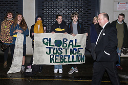 London, UK. 26 November, 2019. Activists from Global Justice Rebellion and London Mining Network protest outside the Mines and Money awards ceremony at the Honorary Artillery Company as mining company delegates, investors and government representatives arrive. The activists were protesting to highlight the environmental impact of mining and the manner in which mining companies are increasingly attempting to 'greenwash' their activities by claiming that they are indispensable in a transition to sustainables.