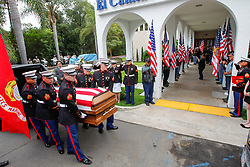 August 15, 2017 - San Diego, California, U.S. - Marines carry the body of Marine Sgt. Chad Elliott Jenson on Tuesday to the El Camino Mortuary and Chapel in San Diego, California.  Jenson was one of nine marines killed July 10 when their KC-130T transport plane crashed in western Mississippi. (Credit Image: © Eduardo Contreras/San Diego Union-Tribune via ZUMA Wire)