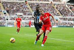 Jordan Henderson of Liverpool clears from Sammy Ameobi of Newcastle United - Photo mandatory by-line: Rogan Thomson/JMP - 07966 386802 -01/11/2014 - SPORT - FOOTBALL - Newcastle, England - St James' Park - Newcastle United v Liverpool - Barclays Premier League.