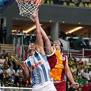 Fenerbahce Ulker's Kaya Peker (L) and Galatasaray's Furkan Aldemir (R) during their Turkish Basketball league derby match  Fenerbahce Ulker between Galatasaray at Sinan Erdem Arena in Istanbul, Turkey, Friday, December 30, 2011. Photo by TURKPIX