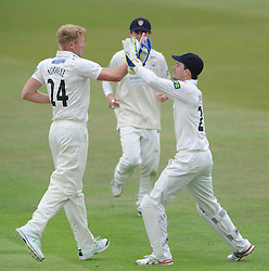 Gareth Roderick of Gloucestershire celebrates with team mate Liam Norwell as Chris Dent of Gloucestershire catches out Rob Keogh of Northamptonshire from Liam Norwell's bowl - Photo mandatory by-line: Dougie Allward/JMP - Mobile: 07966 386802 - 08/07/2015 - SPORT - Cricket - Cheltenham - Cheltenham College - LV=County Championship 2