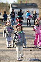 Madelyn and Caroline Guest followed by their family get an early morning start to Thanksgiving Day at Gilford Youth Center's annual 5k Turkey Trot through the Village.  (Karen Bobotas/for the Laconia Daily Sun)
