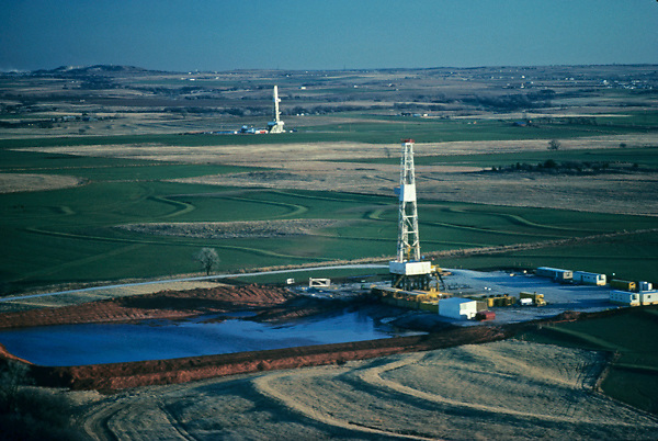 Stock photo of the aerial view of two on-shore rigs