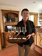 Hochbrudersegg, Styria, Austria. Corona Virus SARS Covid-19 pandemic. Waitress wearing visor.