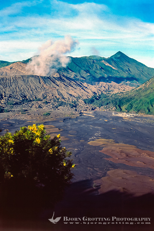 Java, East Java, Mount Bromo. The path to the volcano can bee seen on the plain, in the end of this path there is a Hindu temple.