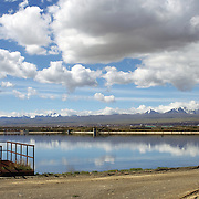 The Bolivian Ministry of Water treatment plant at Puchuckollo, Bolivia is run by state-owned Bolivian water utility EPSAS which manages the water distribution and sanitation services in capital La Paz and neighboring city El Alto.<br /> <br /> <br /> Climate change and the fast diminishing glaciers in the Andes are posing a serious threat to water supplies. Scientists expect that global warming will melt most Andean glaciers in the next 30 years.<br /> La Paz and it's sprawling satellite city El Alto are vulnerable to the effects of climate change and the retraction of the glaciers. Over 2 million people in the region depend heavily on the thawing of Chacaltaya and neighboring glaciers for fresh water. The dams in the highland areas of the Altiplano divide are basically fed by two sources, rainfall and the glaciers, both are suffering from global warming. The declining levels of water in the dams is presenting another problem, contamination and the concentrations of salts, The Bolivian government have launched a number of schemes to help combat the shortage of water and improved water treatment to maintain quality as well as trying to educate and change habits of water usage.<br /> <br /> <br /> Cochabamba, Bolivia, will host the World's People's Conference on Climate Change and the rights of Mother Earth from April 19th to April 22, 2010.