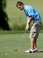 Heritage High's Ryan Volta putts on the 14th hole at the BVAL golf championship at Roddy Ranch Golf Course on Monday, April 30, 2012. (Photo by Kevin Bartram)