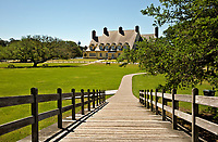 NC01403-00...NORTH CAROLINA - The historic Whalehead Club viewed from the foot bridge and located on the shores of Currituck Sound in Corrola.