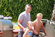 Dad and Kids Getting Ready to Barbecue
