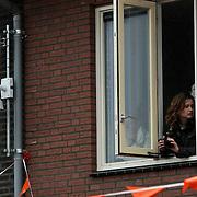NLD/Wemeldinge/20100430 -  Koninginnedag 2010, mobiele camera bevestigd aan de muur van een woning