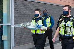 ©Licensed to London News Pictures 28/09/2020  <br /> Croydon, UK. Police officers arriving with flowers for Sgt Matt Ratana at Croydon Custody Centre. The murder investigation continues after the death of police sergeant Matt Ratana at the Croydon Custody Centre in South London last week. Photo credit:Grant Falvey/LNP