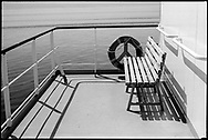 A wooden bench on a small upper deck of the Turkish freighter RORO UND Ege, somewhere in the Mediterranean Sea.