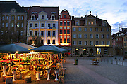 Flower seller, early morning, in the Old Town Square, Wroclaw, Poland.