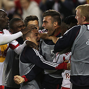 Bradley Wright-Phillips, New York Red Bulls, is mobbed by  team mates after scoring the winning goal in the 90th minute to lead his side to a 2-1 victory during the New York Red Bulls V Sporting Kansas City, Major League Soccer Play Off Match at Red Bull Arena, Harrison, New Jersey. USA. 30th October 2014. Photo Tim Clayton
