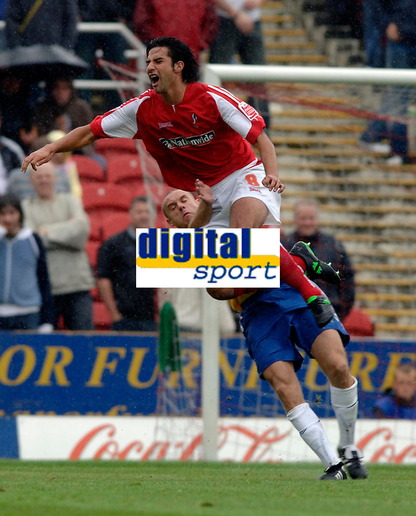 Photo: Henry Browne.<br /> Swindon v Nottingham Forest. Coca Cola League 1.<br /> 13/08/2005.<br /> Rory Fallon of Swindon is fouled by Danny Cullip of Forest.