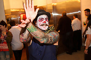 Brooklyn, NY - October 8, 2014: Burlesque performer calls for attention at the opening for Arrogant Swine, a Carolina-style Barbecue restaurant in Bushwick.<br /> <br /> CREDIT: Clay Williams for Arrogant Swine.<br /> <br /> © Clay Williams / claywilliamsphoto.com
