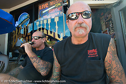 Twin brothers Mark (L) and John (R) Ziriakus live the retired biker life in Daytona Beach and hang here at one of their local favorites, the Boot Hill Saloon on Main Street during the 2015 Biketoberfest Rally. Daytona Beach, FL, USA. October 16, 2015.  Photography ©2015 Michael Lichter.