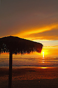 Palapa Silhouette on the Beach at Sunset